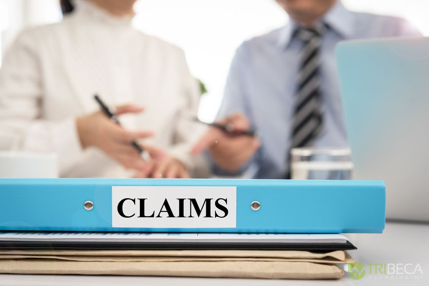 A Picture of a Claims Folder in Front of Two People.