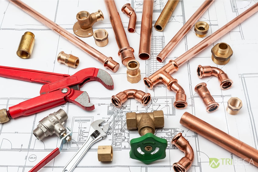 Plumbing Tools Arranged On House Plans With Wrench &Pipe Cutter