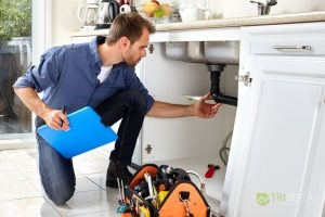 Plumber Checking a Drain as Part of a Plumbing Inspection.